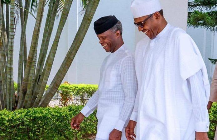 Buhari and Osinbajo walking
