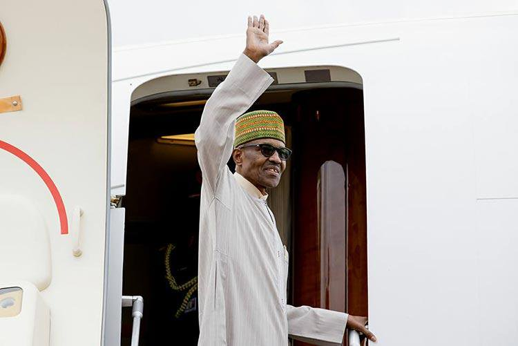 Buhari waving as he departs